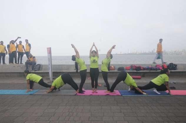 ladies performing yoga
