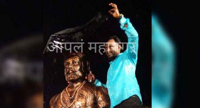 one follower of Chhatrrapati Shiwaji maharaj stand in rain and protect the statue of Shivaji maharaj