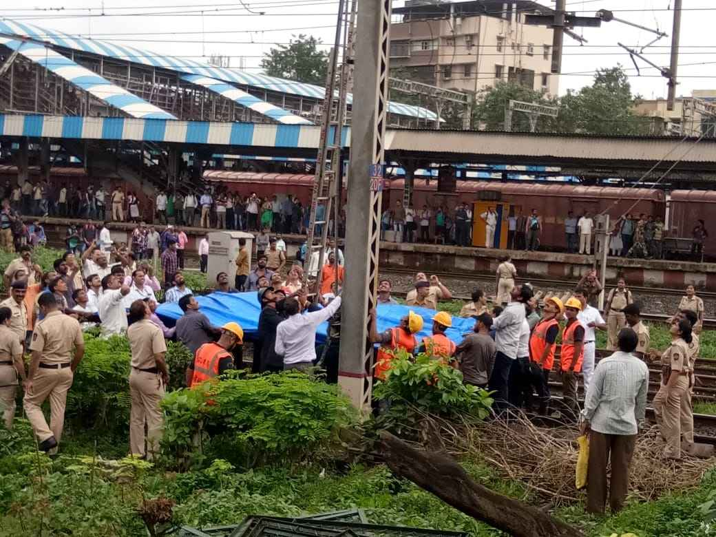Thane railway station one man climb high powered electric pole of railway