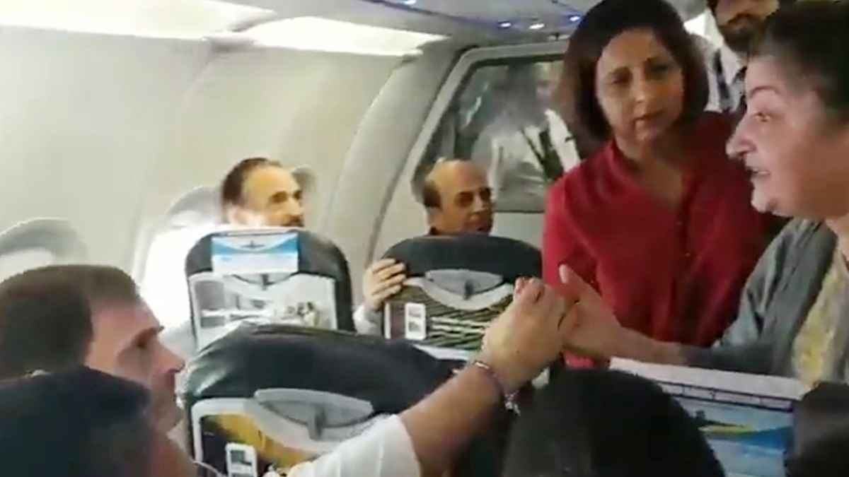 Kashmir Women cries infront of Rahul Gandhi in flight