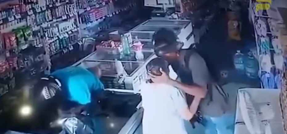 Thief kisses old woman on forehead while robbing store. Viral video tells you why