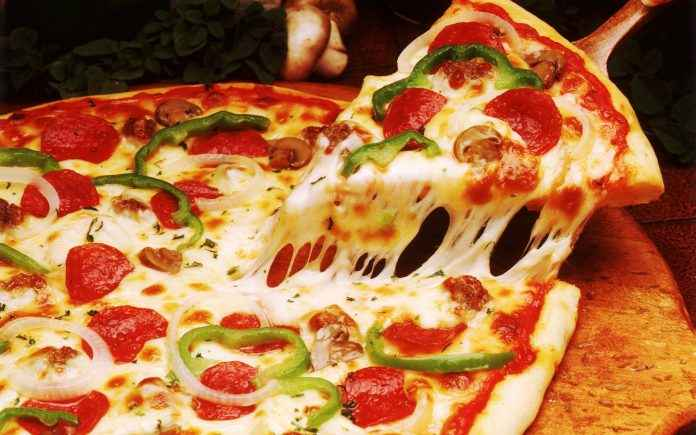 dominos pizza exit four international markets