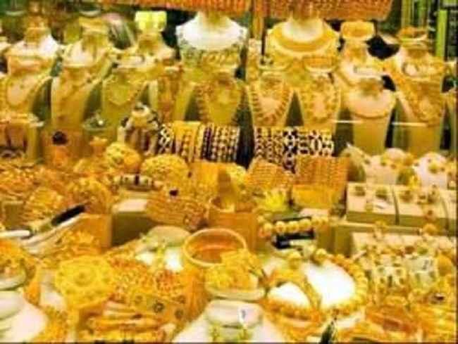 gold price down in spot market
