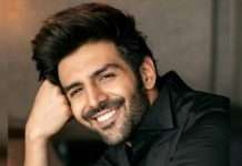 kartik aaryan climbs his car to greet a sea of fans see video viral on social media