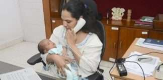 lady ias officer works with baby in hand courtecy - amar ujala