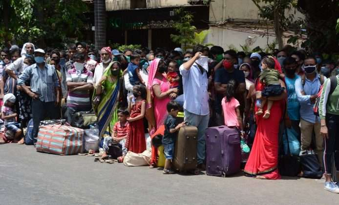Thousand of Migrant workers from Mumbai queue up to board Shramik Special train outside CSMT
