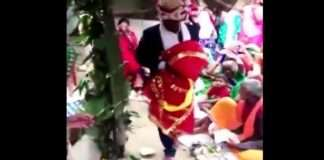 up man marries wooden effigy as his 90 year old father's last wish nck