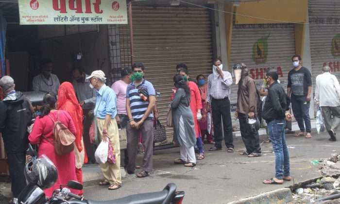 Crowd of account holders outside CKP Bank due to rumors