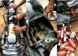 man arrested for carrying illegal alcohol bottles in bike in dry state gujarat watch video