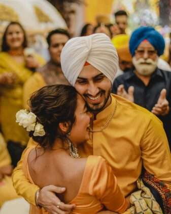 Neha's husband Rohan Preet looks very handsome in a yellow outfit.
