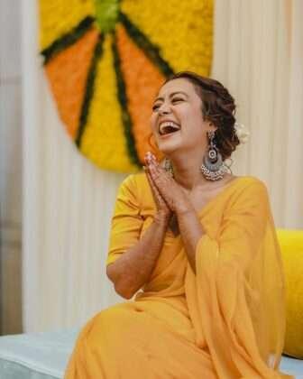 Neha looks very beautiful in a yellow saree.