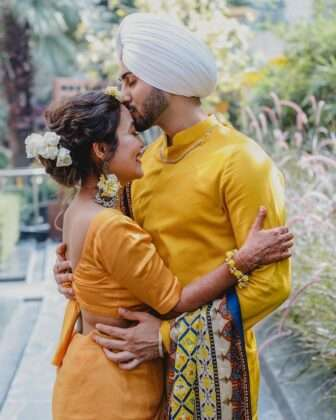 This photo shows the romantic poses of Neha and Rohan Preet.