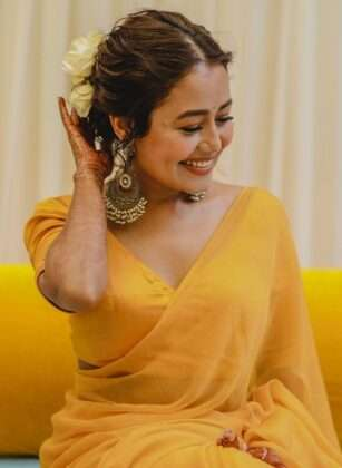 She is wearing floral jewelery with this yellow saree.
