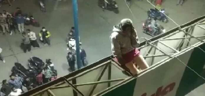 girl sit on ad board for marriage with boyfriend