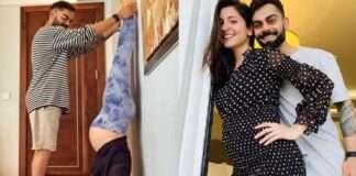 anushka sharma doing headstand shirshasan beside the wall taking virat kohli help