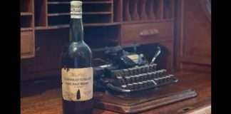 auction a 100 year old whiskey bottel in britain