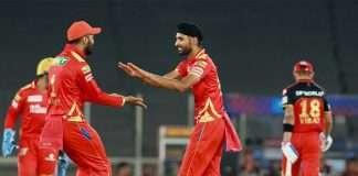 Harpreet Brar of Punjab Kings takes a wicket of Virat Kohli