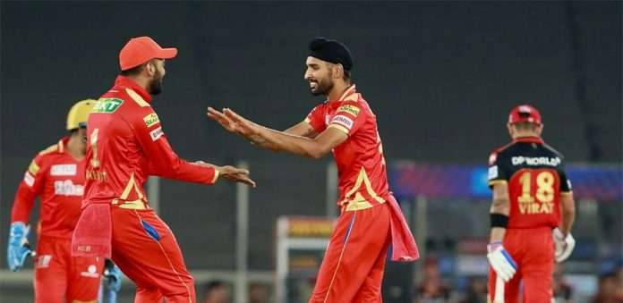 Harpreet Brar of Punjab Kings takes a wicket of Virat Kohli