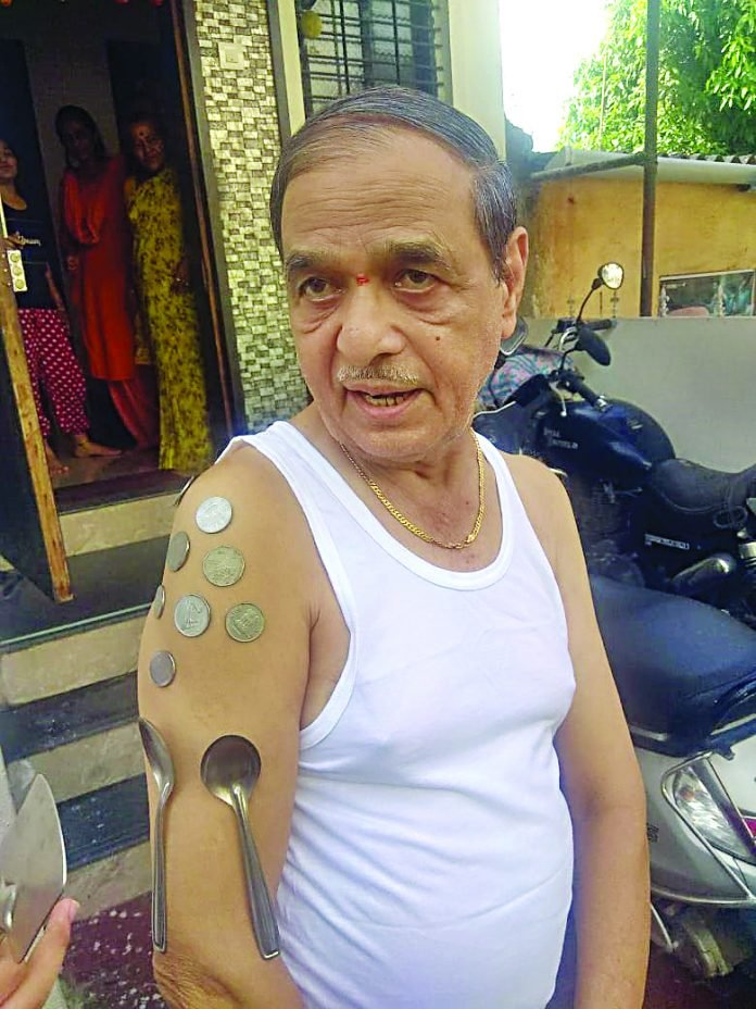 An old man experiencing magnetic energy after vaccination