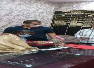 The senior female cleaner sat in her own chair; Retirement Heart Farewell Ceremony