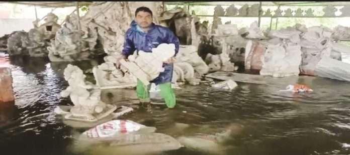 Damage to Ganesh idols in flood waters in Pen